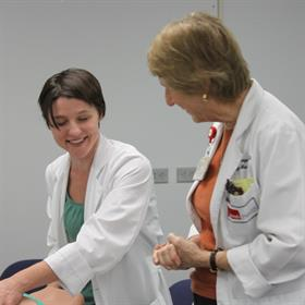 Resident Karen Welch, MD and Barbara Thompson, MD doing a demonstration during a student workshop